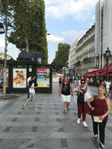 Walking down the Champs Elysees.